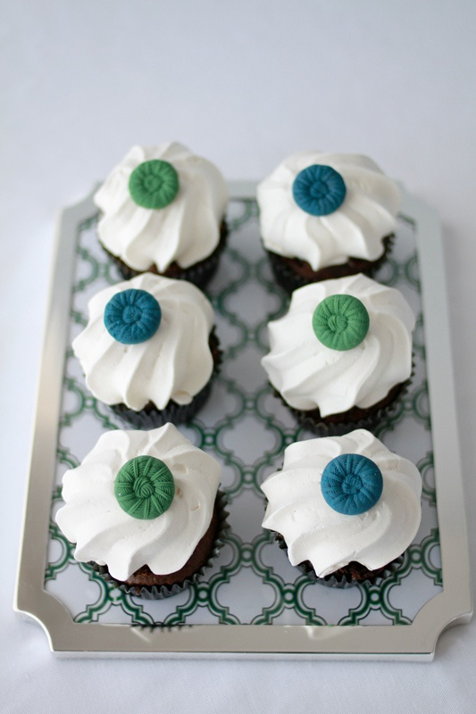 Cute Cupcakes with meringues and buttons.