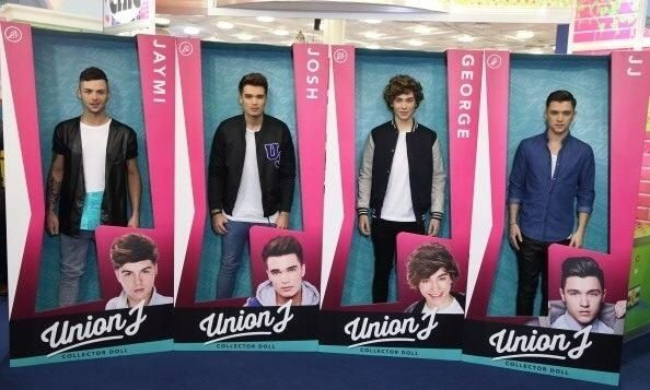 The boys in life size boxes to look like their dolls today at the launch