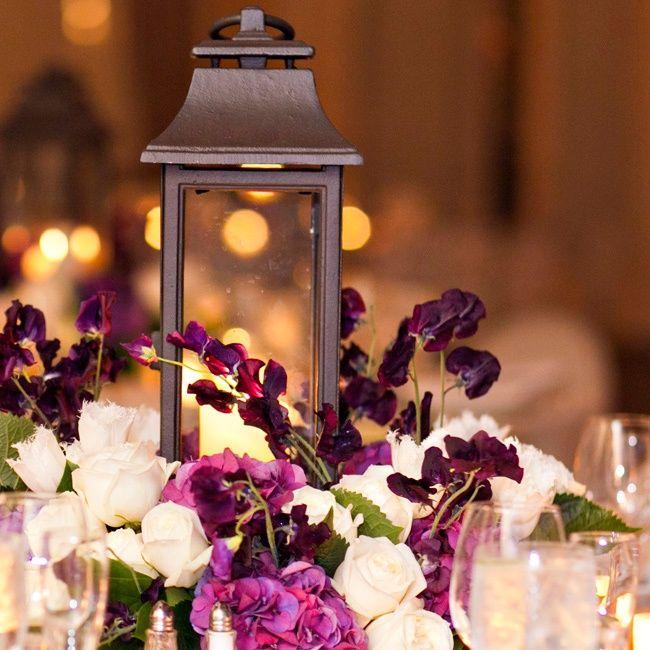 rustic lantern centerpiece | Rustic Lantern Centerpiece with Purple & Cream via The Knot