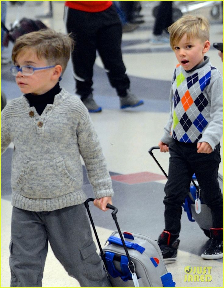 Ricky Martin departs a flight at LAX Airport with his twins Matteo and Valentino on January 5, 2014