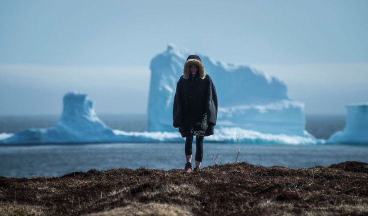 A small fishing village on Canada's East Coast has been hit by a sudden flood of tourists after a 150ft tall iceberg became visible near its shoreline over Easter weekend, and they might have to get used to it.
