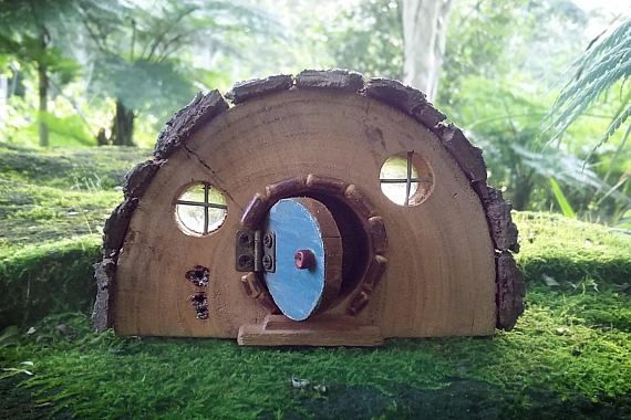 Rustic Wooden Hobbit house with Opening Blue Door and Bark