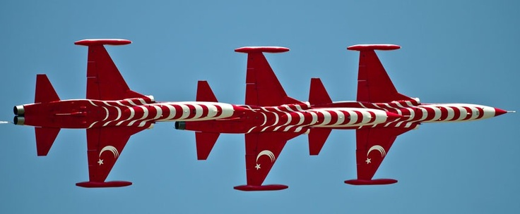 The Turkish Stars, Turkey's Air Force demonstration team, perform during an air show in Bucharest, Romania.