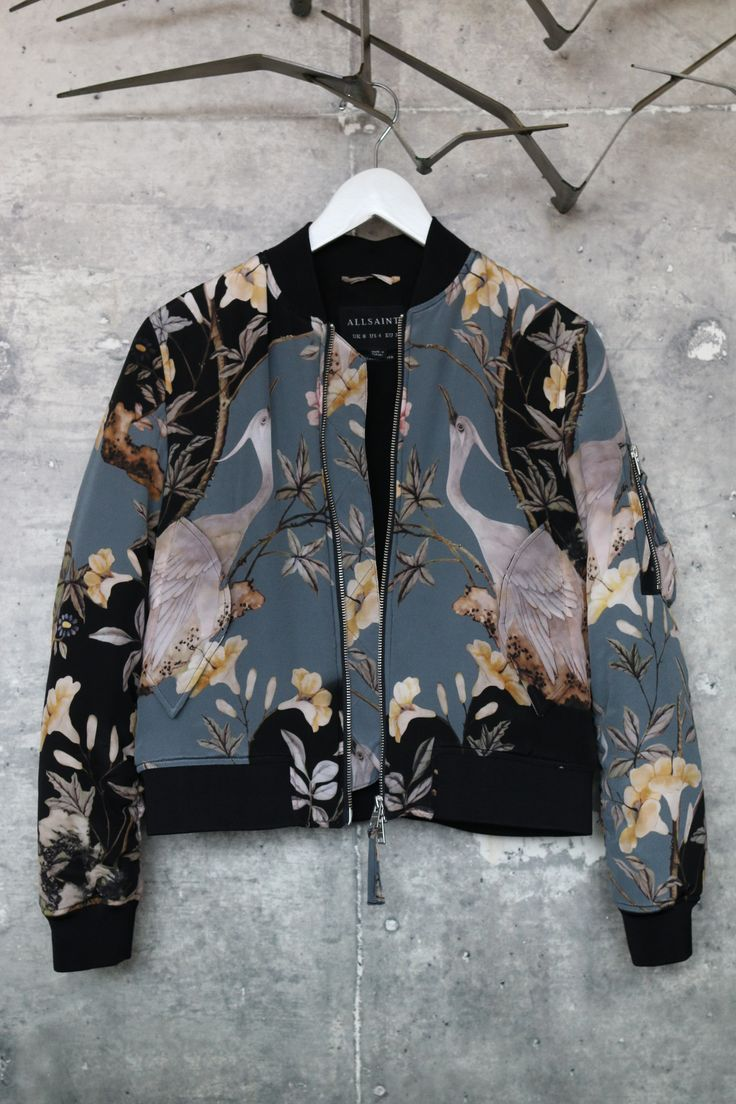 Rare Find — In mint condition From AllSaints, a military inspired bomber jacket printed with a Japanese inspired floral pattern. Material: Main Body Fabric: 100% Silk Lining: 100% Viscose Care: Dry Cl
