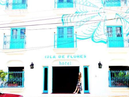 standing in front of hotel isla de flores