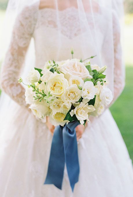 A white bouquet iwth David Austen roses, spray roses, gardenia, and larkspur | Brides.com