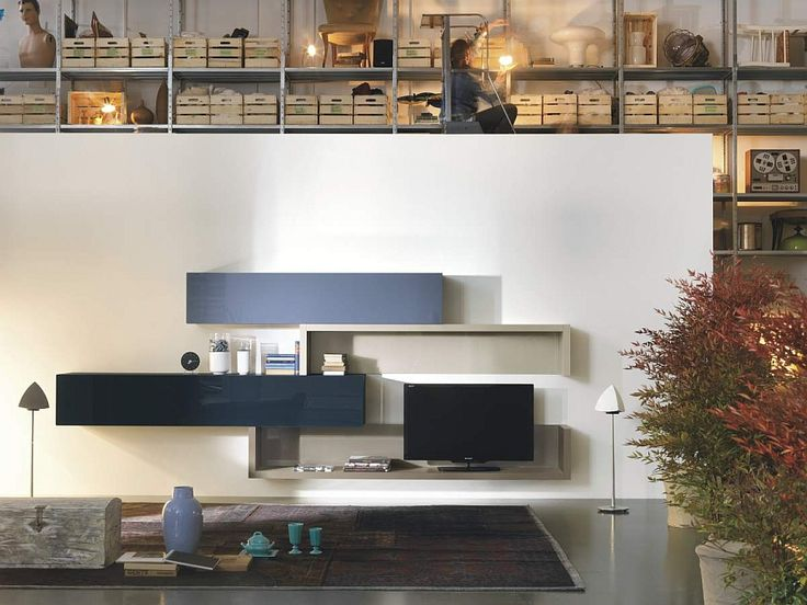 36e8 modular storage units make up the living room entertainment hub Innovative Wall Mounted Units Bring Design Freedom Draped In Sleek Modularity