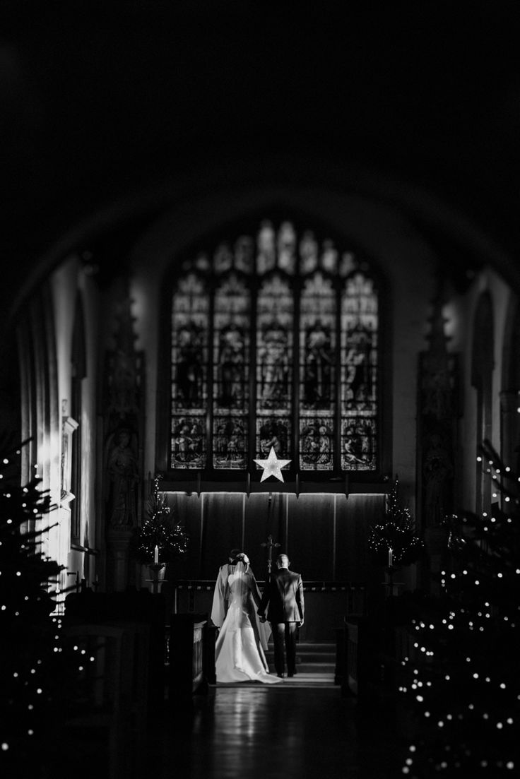 Sharing a moment together as newlyweds before God. Photo by Benjamin Stuart Photography #weddingphotography #burfordchurch #churchwedding #blessing #prayers #justmarried #blackandwhite #brideandgroom