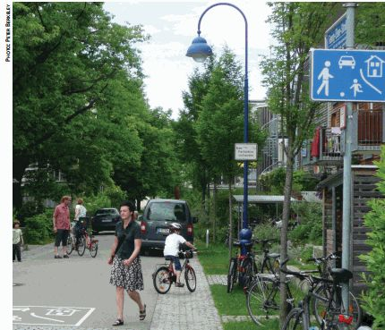 Many German cities have  introduced home zones  or Spielstrassen, an  advanced form of traffic  calming, with a speed  limit of 7 km/h on  neighborhood streets; cars are required by law to yield to cyclists, pedestrians, and children.