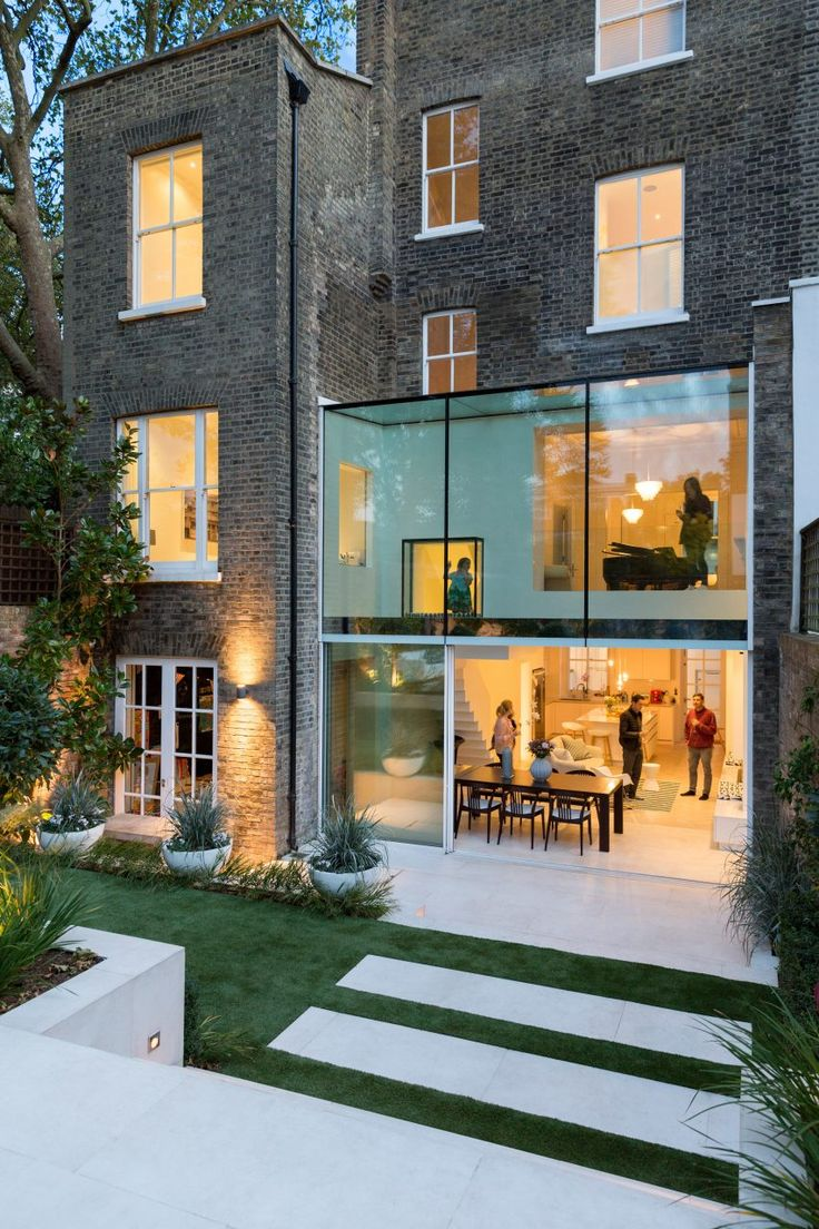 Garden view of this glazed extension for a house in north London by Lipton Plant Architects