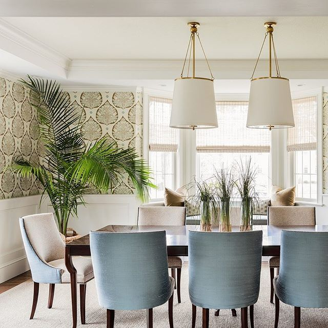 A fabulous dining room with detailed wallpaper, green accents, and inspiring lighting. @leblancdesign