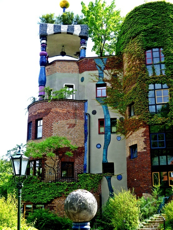 Hundertwasser. This picture shows a very special house designed by the famous german architect Hundertwasser, who designed many buildings and stations in Germany