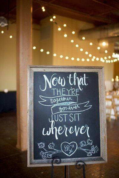 """Rustic chalkboard wedding reception sign idea - """"Now that they're together forever, just sit wherever"""" {Mandi Mitchell Photography}"""