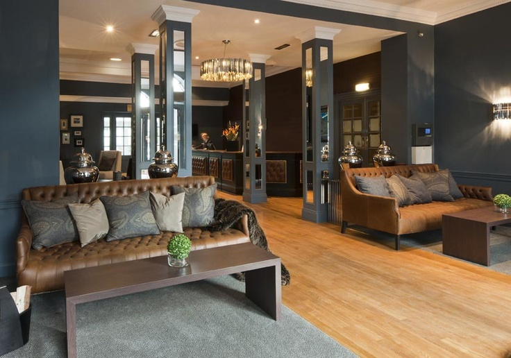 The Roxburghe Hotel, Edinburgh. A stylish hotel reception by Glasgow based Interior Designers, Occa Design.Button backed leather sofas, tan leather, grey blue interior, welcoming spaces