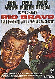 Rio Bravo (1959)  directed by Howard Hawks. Stars John Wayne, Dean Martin, and Ricky Nelson, with Angie Dickinson, Walter Brennan, and Ward Bond.