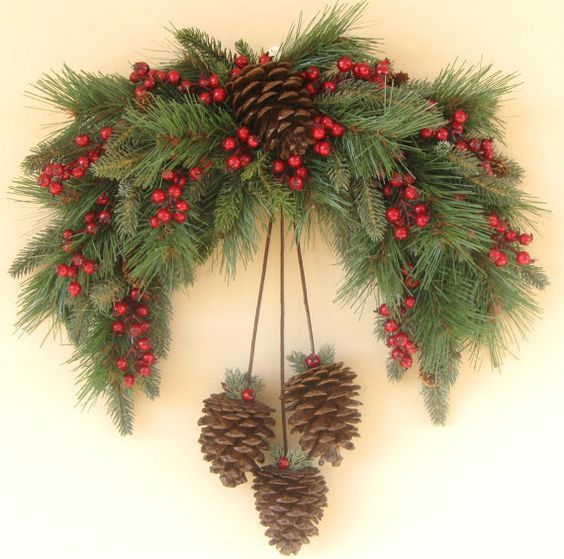 Bring a rustic look to your home this holiday season with this Winter Pine Swag Wreath. The arch is an abundant mix of thick evergreens. The dark red berries and real pine cones offer the softest hints of color against the lush greens. Neutral and subdued, the Winter Pine Swag Wreath is great as a transitional decoration throughout the winter.