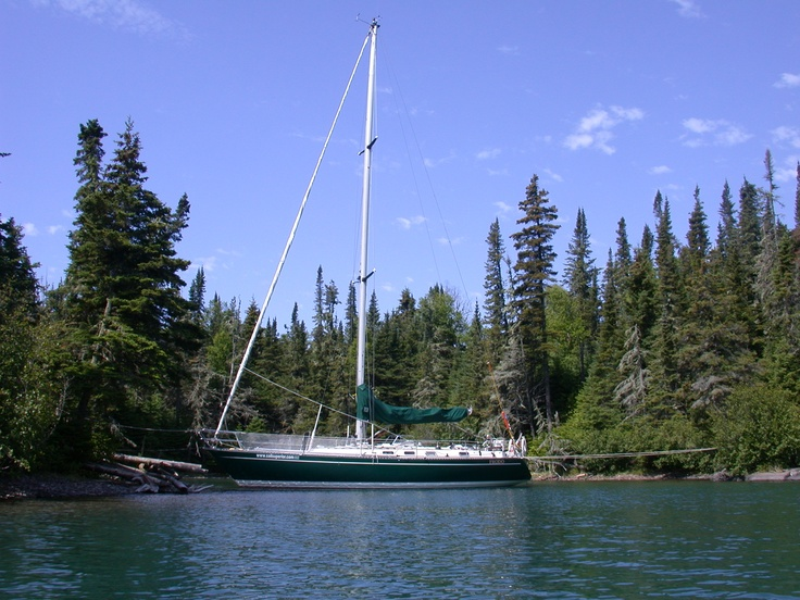 """Lake Superior is so full of little nooks and crannies to keep your boat safe when the winds whip up the big waves. Here in Horseshoe cove a 40 ft boat """"Frodo"""" with a 7 ft draft is cozy and safe. You can step right off the bow of the boat onto shore. And there is a little fire pit for telling ghost stories of ships lost at sea - or in this case Lake Superior."""