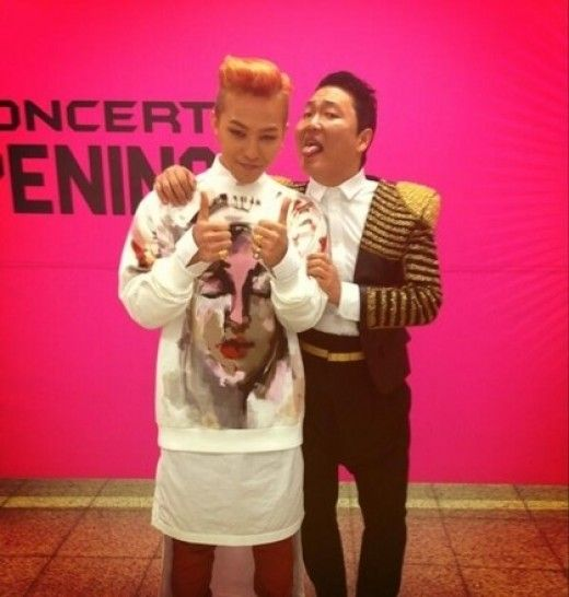 "G-Dragon snaps a risqué picture with Psy after the epic ""HAPPENING"" concert"