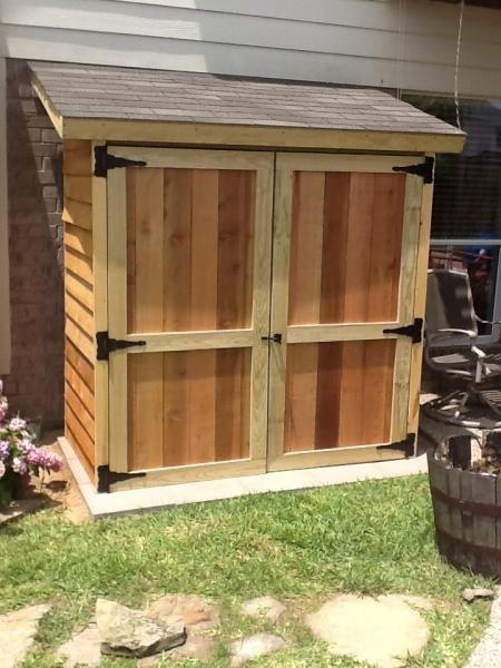 Small lean-to style cedar shed. Perfect if you have a few garden tools and supplies to store.