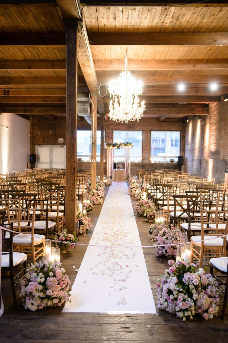 Industrial space turned glam #ceremony #decor Photography: Averyhouse - averyhouse.net Read More: http://www.stylemepretty.com/2014/08/07/industrial-chic-chicago-wedding/