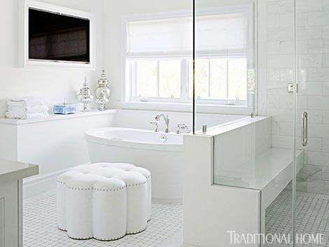 An all white master bath is brought to life with textural for Master bathroom ottoman