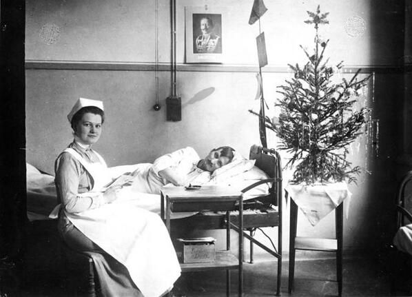 A severely wounded soldier cared for by a nurse during a lonely WWI Christmas in Germany.