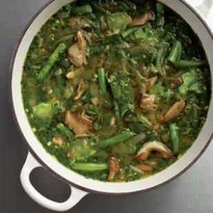 Green Curry Soup Recipe by eatingwell: Packed with spinach, mushrooms, green beans and broccoli stems (save the florets for another night). Green curry paste gives this soup a delicately spicy broth. The vegetables are cooked just enough to be tender, but retain their freshness and distinct textures #Soup #Green_Curry #Healthy