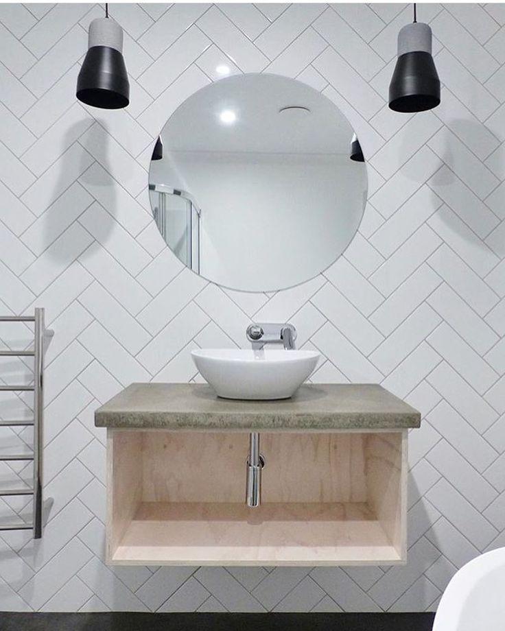 White Herringbone Tiled Wall, Light Timber Vanity With Moss Green Top,  White Round Basin