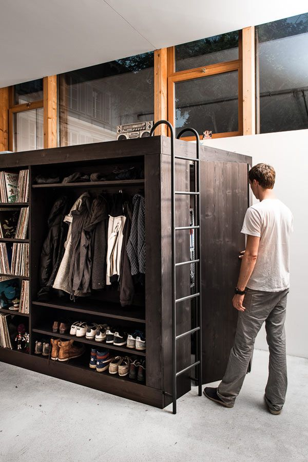 Germany-born, Switzerland-based designer Till Koenneker took matters into his own hands when he moved into a studio apartment that had no storage. Building a simple cube-like design, called The Living Cube, he found space for his vinyl collection, TV, clothes, and shoes. On top of the cube, Koenneker was able to incorporate a bed for guests and inside houses a much-needed storage space. http://design-milk.com/the-living-cube-by-till-koenneker/
