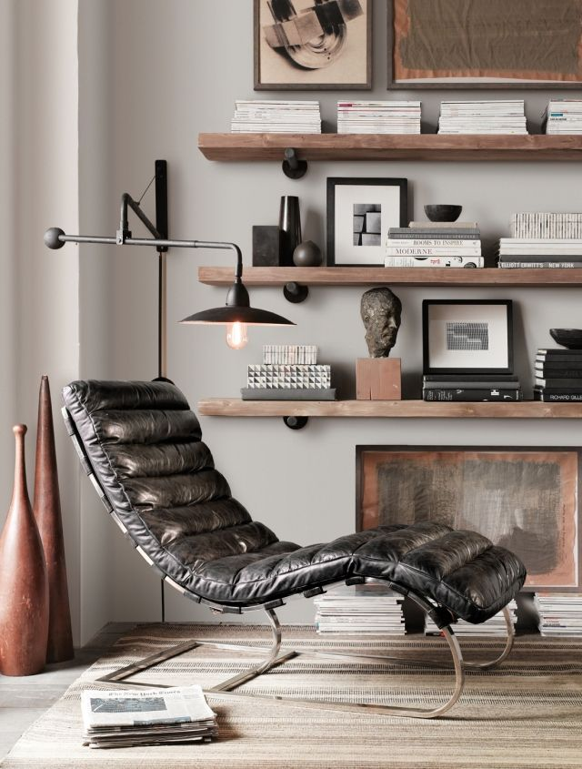Restoration Hardware - Great leather lounge chair and wood shelving with cool hanging lamp and Jute rug.