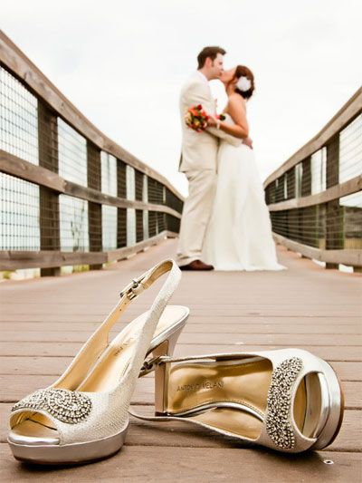 Shoe shot, bride and venue in background