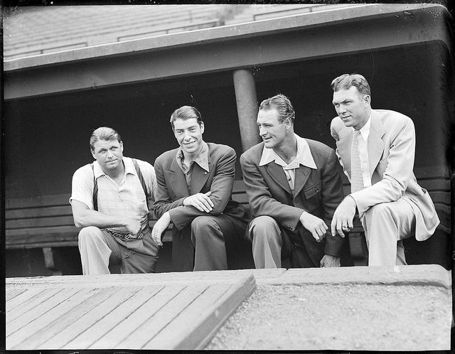 1937 -Jimmie Foxx, Joe DiMaggio, Lou Gehrig, and Bill Dickey (all in civvies) on dugout steps at Fenway Park.