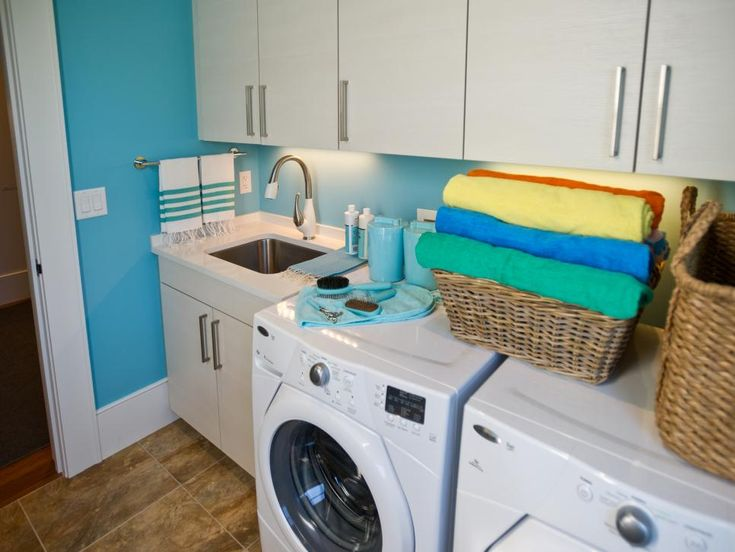 HGTV.com showcases the stylish laundry room at HGTV Dream Home 2013, which boasts German cabinetry, bright turquoise walls and hardworking stone tile flooring.
