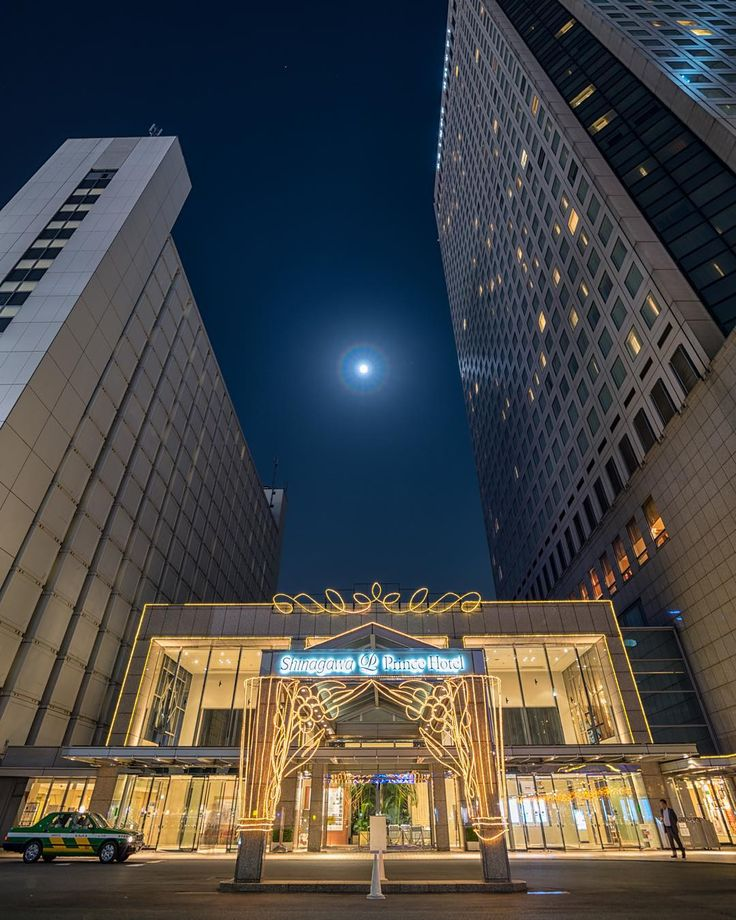 Whenever I felt lost I looked to her light to lead me back home. - As often as Ive stayed at the #ShinagawaPrinceHotel in #Tokyo #Japan Ive never taken the time to take a proper shot of the main entrance. Its always lit up wonderfully so Im not sure why its taken me so long to get a decent shot of it. So one night during one of my precious stays when I got back to the hotel and after picking up some late night snacks at the 7-11 just a few feet away I decided to grab this shot. The moon was…