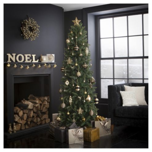 Gorgeous slim Christmas tree with gold decorations - love the dark walls and the tree