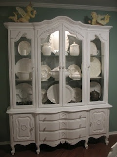 Paint an old china hutch one color and fill with the same color china, plates and platters