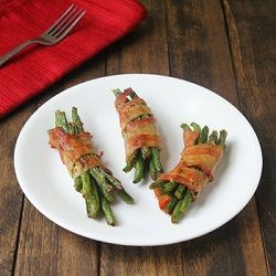 Seasoned green beans wrapped in bacon make a great side dish or appetizer.