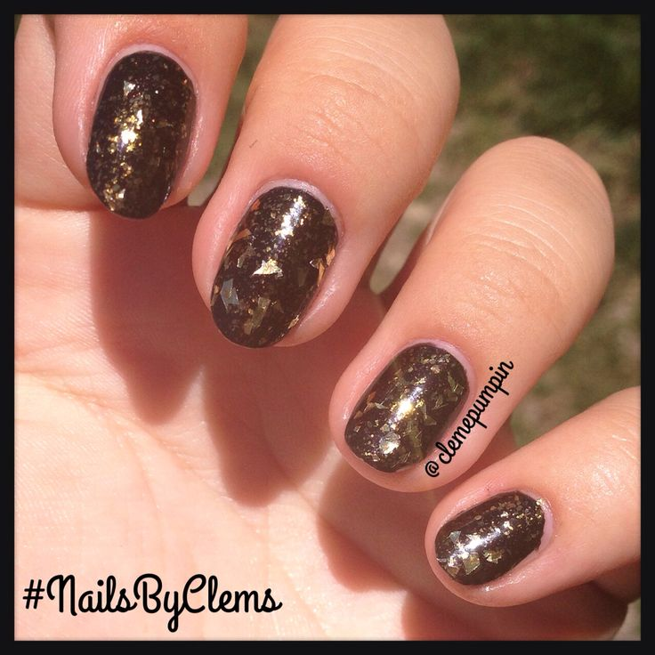 """Hi there! My #notd showing off these amazing polishes; """"Running Wild"""" by #catrice from the #feathers&pearls #collection , topped with @sephora #formulaX #golden #flakes """"Out Of Sight""""  hope you girls like it! #nails #nailart #nailsdid #nailswag #nailstyle #nailstagram #nailartchile #nailartdaily #nailsbyclems #nailartjunkie #black #glam #uñas #unhas #unhasdasemana #ongles #mani #manicure #manioftheday"""