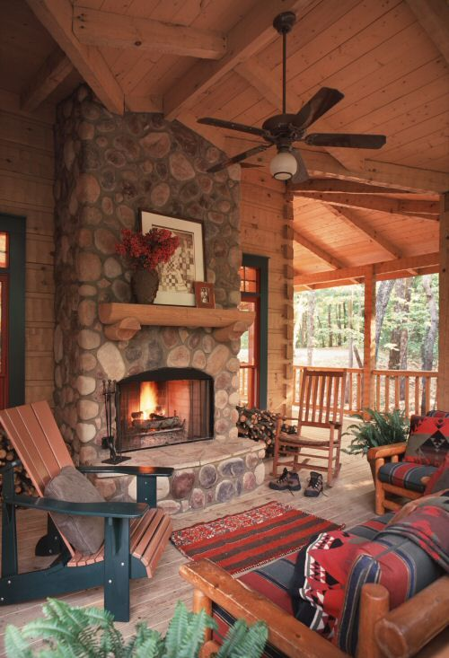 The outdoor living spaces of the Ellijay Cabin help to make this a cabin to be enjoyed year round. Many marshmallows have been toasted at this fireplace. www.modernrustichomes.com