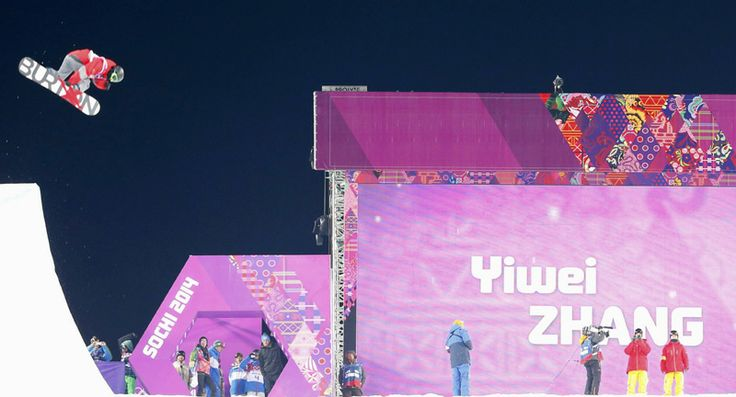 China's Zhang Yiwei performs a jump during the men's snowboard halfpipe semi-final event at the 2014 Sochi Winter Olympic Games, in Rosa Khutor February 11, 2014