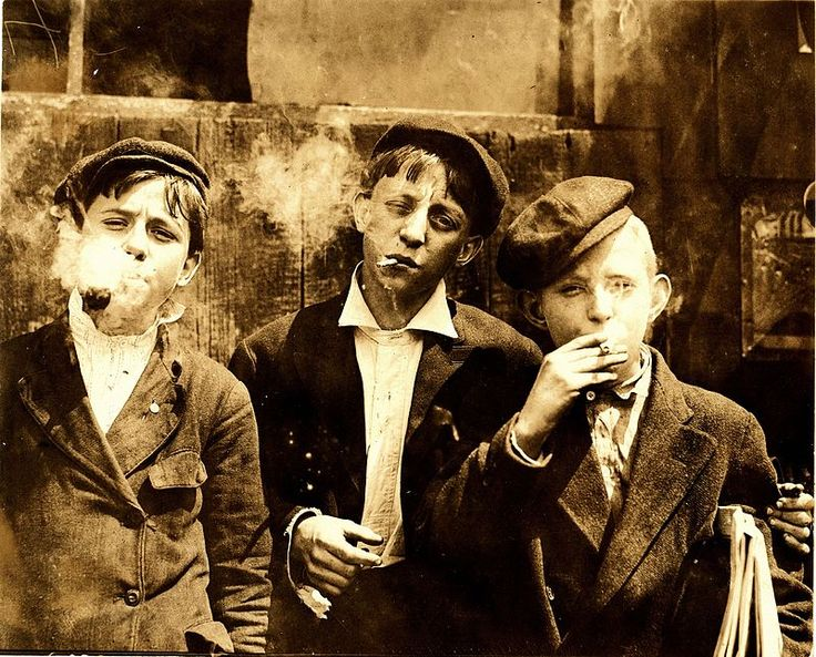 11:00 A. M . Monday, May 9th, 1910. Newsies at Skeeter's Branch, Jefferson near Franklin. They were all smoking. Location: St. Louis, Missouri. Photograph by Lewis Wickes Hine, 9 May 1910.