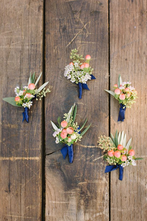 peach berry boutonnieres - photo by Julie Wilhite Photography http://ruffledblog.com/eclectic-outdoor-texas-wedding
