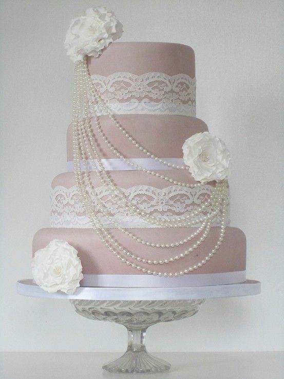 Vintage Style Wedding Cake Covered In A Coloured Icing To Compliment The Lace And Satin Ribbon Around Each Of Tiers Pearl Beaded Necklace Is Draped