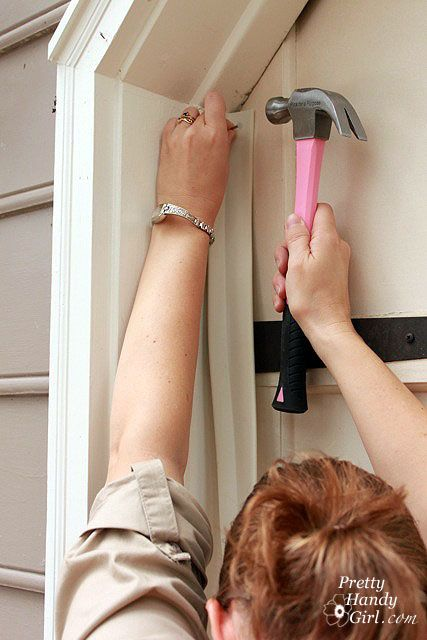 How to add weather stripping to  garage doors.  http://www.prettyhandygirl.com/wp-content/uploads/2012/01/nailing_at_corner.jpg