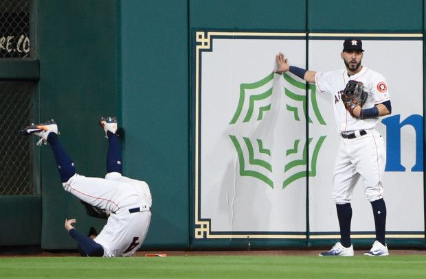 October 21, 2017:  Astros blank Yankees in ALCS Game 7, will meet Dodgers in World Series.  Houston Astros' George Springer catches a fly ball hit by New York Yankees' Greg Bird in front of Marwin Gonzalez during the seventh inning of Game 7 of baseball's American League Championship Series Saturday, Oct. 21, 2017, in Houston. (AP Photo/Eric Christian Smith)
