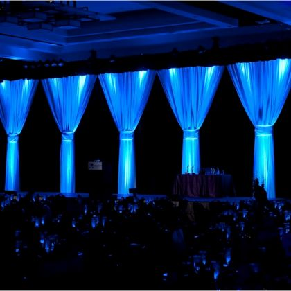 Event Drapes | White drape on black drape with blue lighting