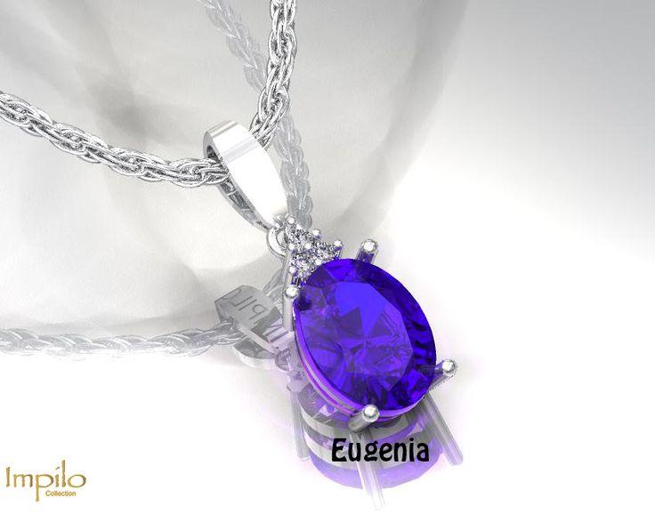 """Eugina"" - Oval cut tanzanite centre stone with round brilliant cut diamonds above it forming a triangular shape."