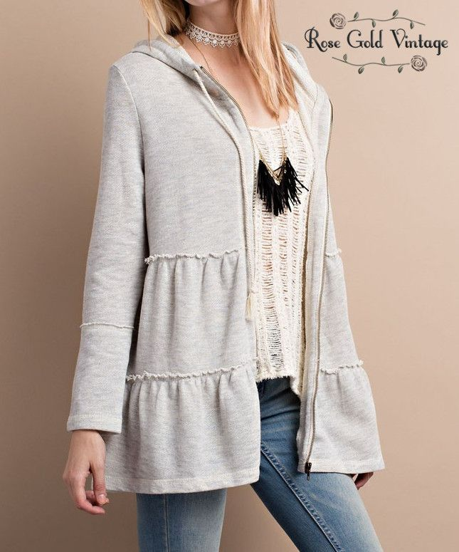 This hoodie has the perfect feminine details! Super soft, with babydoll tiered styling. Available in sizes Small, Medium & Large. This style runs generous. Cotton/Poly blend. Also available in oatmeal