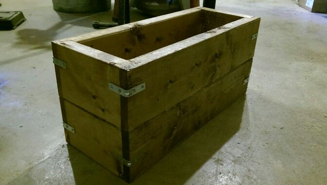 This is anice rustic planter box.  It will hold several plants and it weatherproof for 10 years.  It has strong joinery, no need to bring it in during a storm.  It will definitely protect your plants.