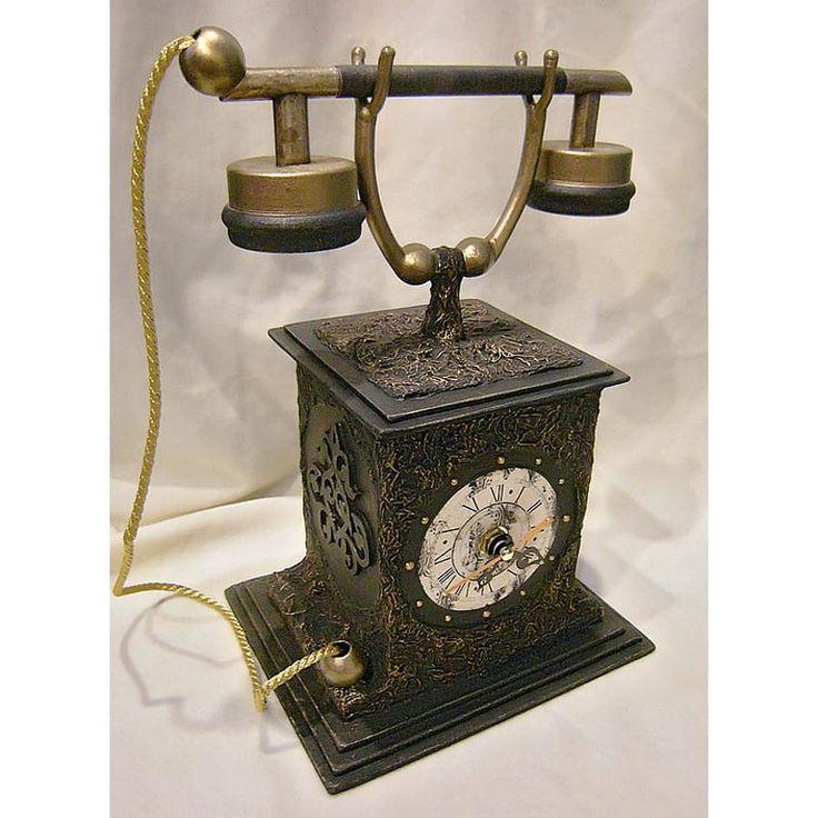 Роскошные интерьерные часы hand made в виде телефона в стиле ретро со старинной трубкой на вилке, шнурком, инкрустированные ажурной сеткой. Внутри телефонной коробки находятся кварцевые часы,питание в часах от батарейки. Задняя стенка часов съемная для доступа к механизму и батарейке.Пре